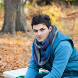 Young man in park. Royalty Free Stock Images