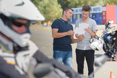 Young man passed drivers license. Young men passed his drivers license Royalty Free Stock Photo