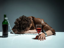Young man passed out from alcohol Stock Images
