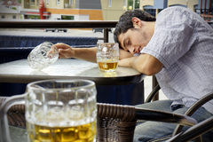 Young man passed out drunk stock image