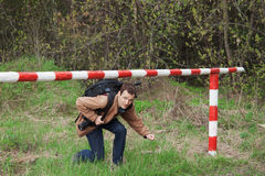 A young man passes under the barrier Royalty Free Stock Image