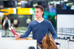 Young man with passports and boarding passes at Stock Photography