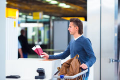 Young man with passports and boarding passes at Royalty Free Stock Images