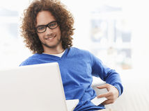 Young man paying with a credit card online Royalty Free Stock Photography