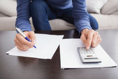 Young man paying his bills Royalty Free Stock Images
