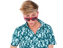 Young man peeking over sunglasses Stock Photos