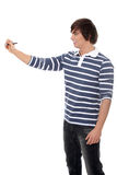Young man with a pen. Stock Image