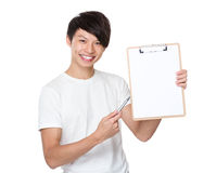 Young man pen point to blank page of clipboard Stock Images