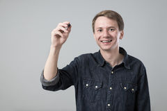 Young man with pen Stock Photo