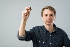 Young man with pen Royalty Free Stock Image