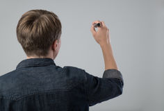 Young man with pen Royalty Free Stock Photos