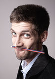 Young man with pencil Royalty Free Stock Photo