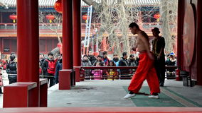 The young man perform unique skills in Dongyue Temple during Chinese Spring Festival in Beijing stock video