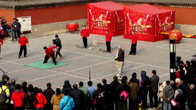 The young man perform unique skills near Dongyue Temple during Chinese Spring Festival in Beijing, China1 stock video