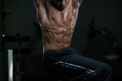 Young Man Performing Abdominal Exercises Royalty Free Stock Photo