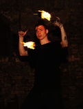 Young Man Performing with Fire Stock Images