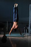 Young man performing handstand in fitness studio Stock Photography