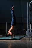 Young man performing handstand in fitness studio Royalty Free Stock Photos