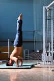 Young man performing  handstand in fitness studio Stock Image