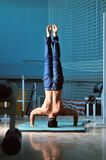 Young man performing  handstand in fitness studio Royalty Free Stock Photography