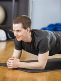 Young Man Performing Plank Position In Gym Royalty Free Stock Photos