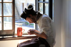 Young man performing soldier's duties as tailor,Fort Ticonderoga,New York,2014 Royalty Free Stock Images