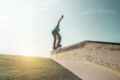 Free Young Man Performing With Skateboard Up Ramp At Sunset In Urban City Park - Skater Having Fun With Back Sunlight - Extreme Sport, Royalty Free Stock Photos - 169960258