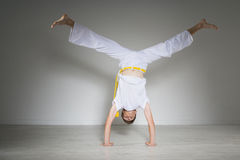 Young man performs a handstand, capoeira. Stock Images
