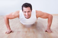 Young man performs pushup Royalty Free Stock Photography