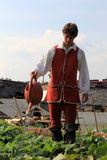 Young man in period dress, watering garrison garden,Fort William Henry,Lake George,New York,2015 Stock Photography