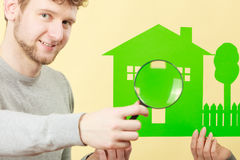 Young man with person and house. Royalty Free Stock Images