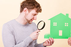 Young man with person and house. Royalty Free Stock Photo