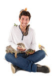 Young man with pets. Young man with several pets isolated in white Royalty Free Stock Photography