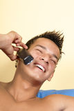 Young man on the phone Royalty Free Stock Images