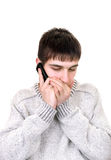 Young man with phone Stock Images