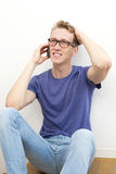 Young man on the phone Stock Photography