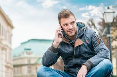 Young man on phone calling. Guy talking on smartphone Royalty Free Stock Photos