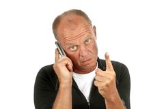 Young man on the phone expressing a warning Royalty Free Stock Image