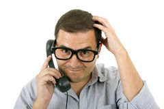 Young man with a phone and glasses. Isolated on white Royalty Free Stock Photography
