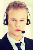 Young man with phone-headset Royalty Free Stock Photography