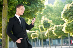 Young Man with Phone in Park Royalty Free Stock Image
