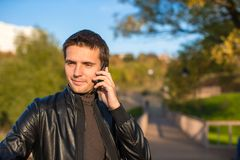 Young man with a phone in the park Royalty Free Stock Images