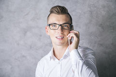 Young man on phone Stock Images