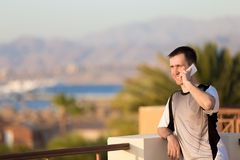 Young man on phone in sea resort Royalty Free Stock Photo
