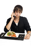 Young man on phone about to eat Royalty Free Stock Photo