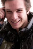 Young man on phone in winter Stock Photo