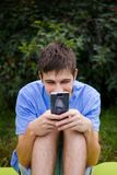 Young Man with a Phone royalty free stock photography