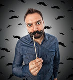 Young man with photo booth shaped mustache Royalty Free Stock Photo