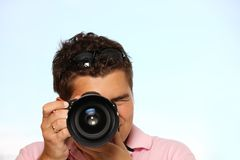 Young man with photo camera. Taking pictures Royalty Free Stock Photos