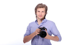 Young man with photo camera Stock Images